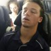 Josh Shaw on the plane to New Mexico, deep in thought. thumbnail