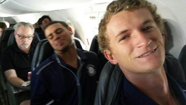 Jason Bush (forefront), Mike Martinez (background) on the plane to New Mexico.